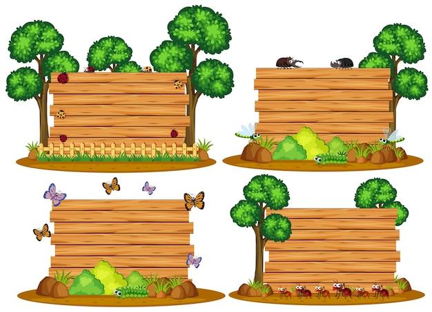 Cztery drewniane deski z robakami i drzewami