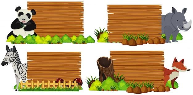 Cztery drewniane deski ze zwierzętami