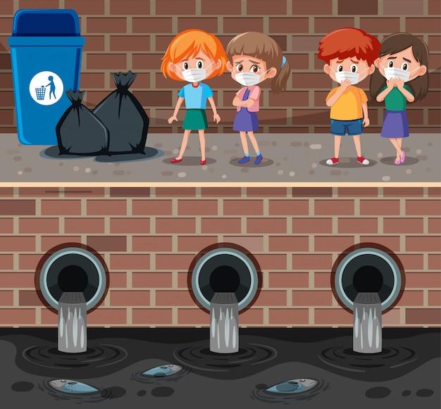 Czworo dzieci z maską stojącą przy brudnym kanale