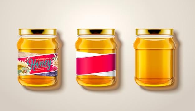 Czysty słoik miodu, widok z góry na szklane słoiki z miodem na ilustracji, niektóre z etykietami i opakowaniem