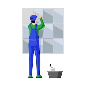 Dachówkowa warstwa przy pracy mieszkania ilustracją. profesjonalny mechanik mocowania płytek do ściany postać z kreskówki. wykwalifikowany robotnik, złota rączka, specjalista od robót budowlanych dekorujący pionowe powierzchnie wewnętrzne