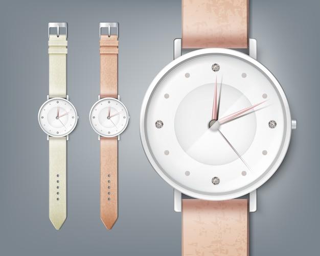 Damski zegarek z klejnotem, na białym tle z bliska na szarym tle