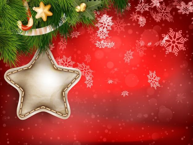 Dekorację świąteczną z gałęzi jodłowych na czerwono.