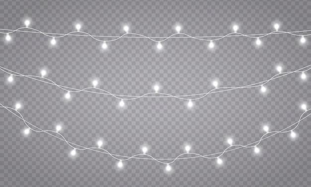 Dekoracje wiankowe. lampki choinkowe, na białym tle na przezroczystym tle. świecące światła na kartki świąteczne, banery, plakaty, projekty stron internetowych. ledowa lampa neonowa. ilustracja wektorowa, eps 10