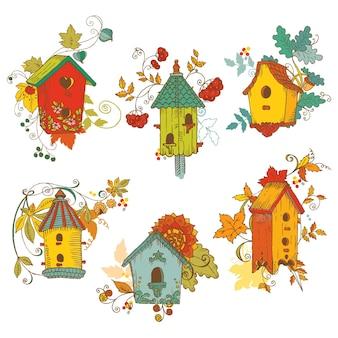 Dekoracyjne Jesienne Gałęzie Z Birdhouses Premium Wektorów