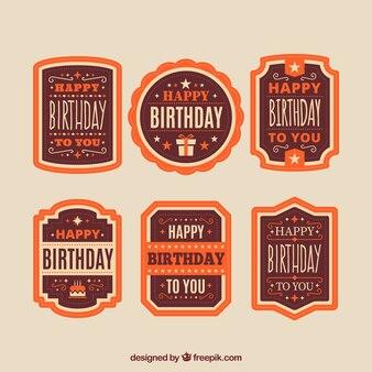 Dekoracyjne odznaki urodziny w pomarańczowych kolorach