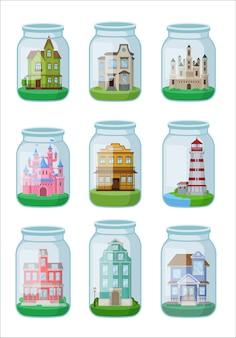 Dekoracyjni domy w szklanym słoju na białym tle.