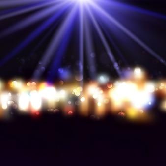 Dekoracyjny tło z bokeh światłami i starburst