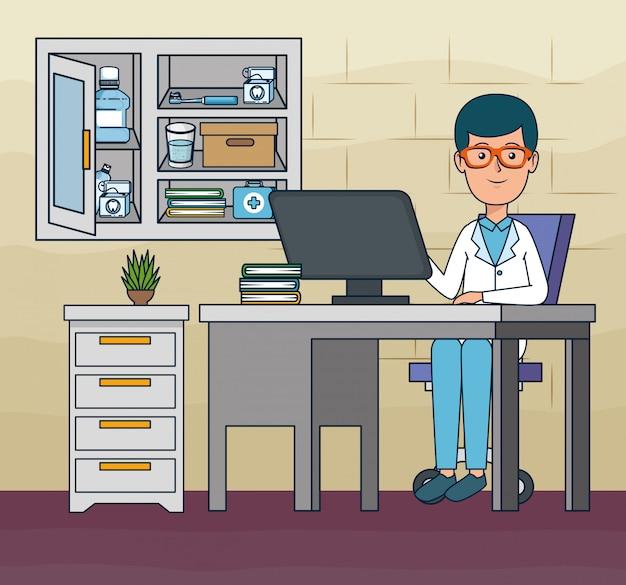 Dentysty mężczyzna w biurze z komputerem i książkami