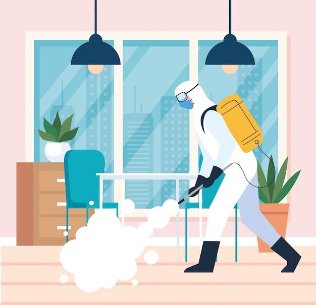 Dezynfekcja domu przez komercyjne usługi dezynfekujące, pracownik dezynfekcji w kombinezonie ochronnym i sprayu zapobiegającym covid 19