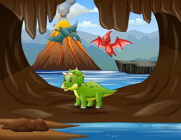 Dinozaury z kreskówek na ilustracji jaskini