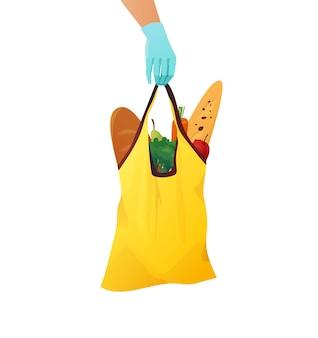 Dłoń kuriera w rękawiczce trzymająca żółtą bawełnianą eko torbę z artykułami spożywczymi