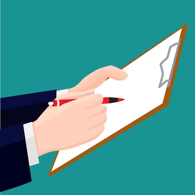 Dłoń trzymająca długopis