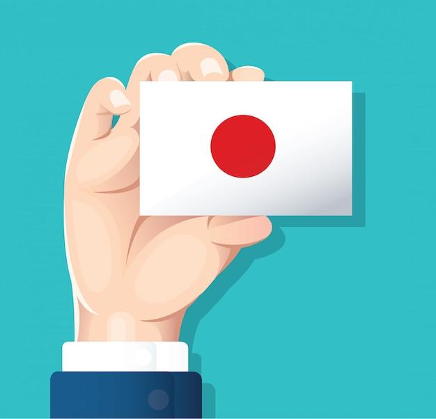 Dłoń trzymająca flagę japonii