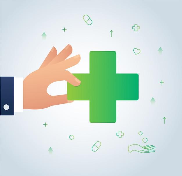 Dłoń trzymająca ikonę medycznych