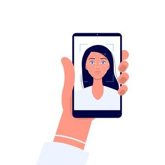 Dłoń trzymająca telefon z kobietą kreskówka na ekranie