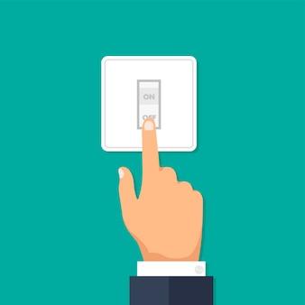 Dłoń z palcem wskazującym wciskająca przełącznik włączania i wyłączania światła przycisk elektryczny