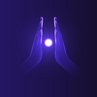 Dłonie z dłońmi przyciśniętymi do siebie, między którymi znajduje się jasna kula energii. koncentracja, relaks, pomoc, joga, koncepcja wiary.