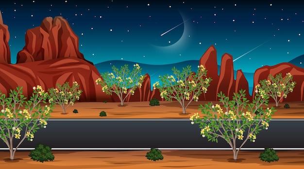 Długa droga przez scenę pustynnego krajobrazu w nocy