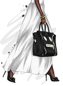 Długie kobiece nogi w pięknej spódnicy i butach na wysokim obcasie. stylowa torba.