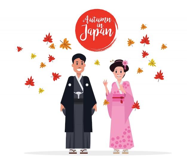 Dobiera się japończyków z tradycyjnym kostiumem w jesieni