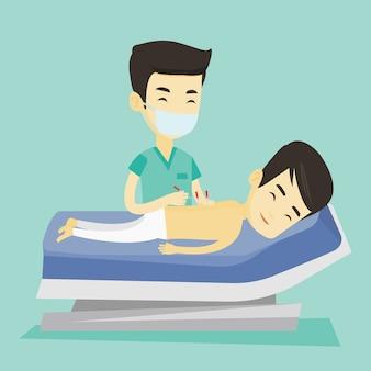Doktor akupunktury dokonywanie terapii akupunktury.