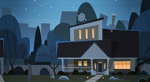 Dom budynek nocny widok przedmieście wielkiego miasta