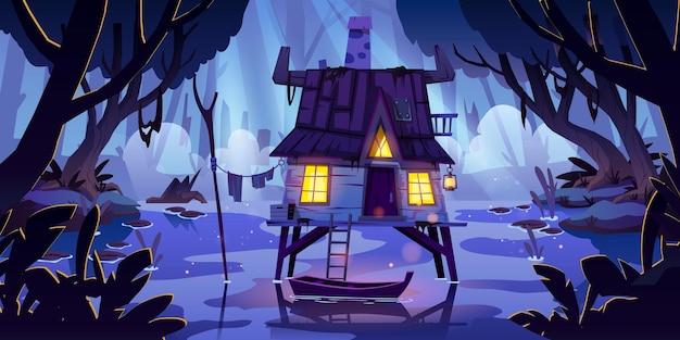 Dom na palach na bagnach z łodzią w nocy