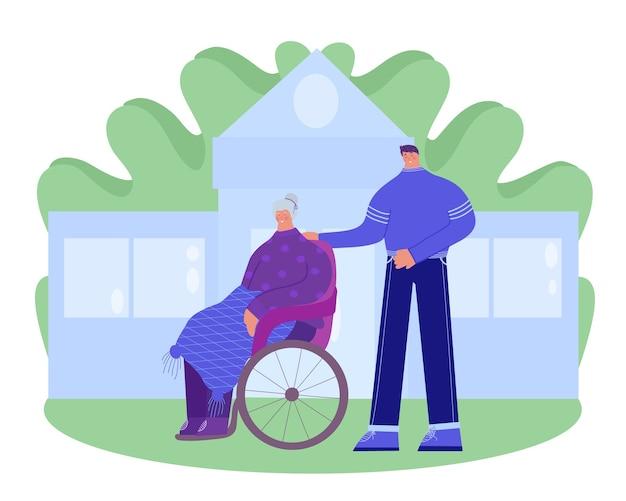 Dom opieki. wolontariusz pomaga starszej niepełnosprawnej kobiecie.