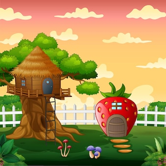 Dom truskawkowy i domek na drzewie w krajobrazie parku