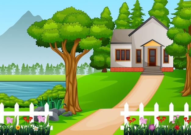Dom w pięknej wiosce z zielonym podwórzem pełnym kwiatów