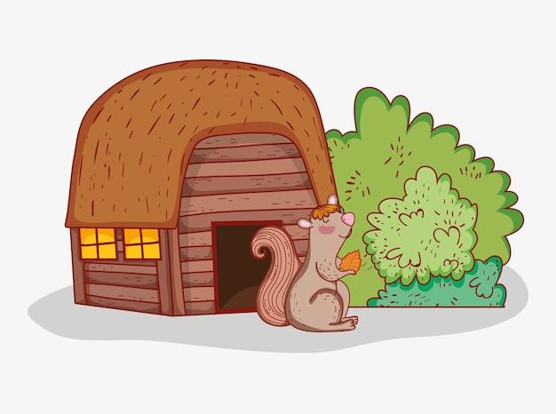 Dom z drewna z wiewiórką i liści jesienią