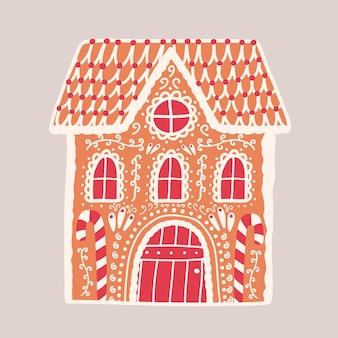Dom z piernika na białym tle. dekoracyjna konfekcja w kształcie budowli