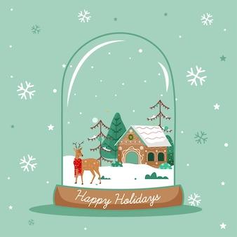 Dom z reniferów i drzewa wewnątrz kuli śniegu
