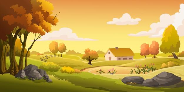 Domy i łąki na wzgórzu o zachodzie słońca.