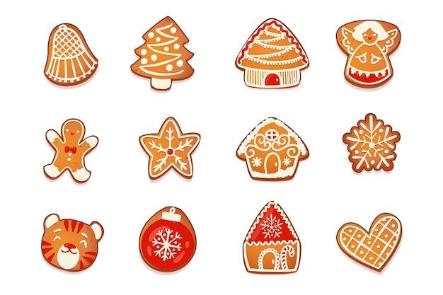 Domy z piernika i zestaw ciastek. śliczne świąteczne tradycyjne postacie z białym lukrem dekoracji. ilustracja wektorowa.