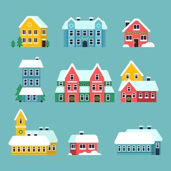 Domy zimowe. święta miejskie święta śnieżne miasto płatki śniegu na dachu domu kreskówka zestaw