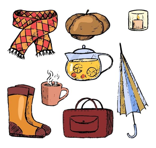 Doodles zestaw jesiennych przytulnych elementów. teczka, parasol, czajnik, kubek, szalik, buty, beret, świeca. ręcznie rysowane ilustracje wektorowe kolekcji. kolorowe obiekty na białym tle do projektowania