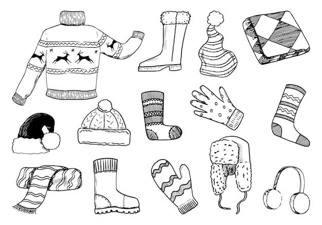 Doodles zestaw przytulnych zimowych ubrań. sweter, buty, rękawiczki, mitenki, czapki, szalik, skarpetki. ręcznie rysowane ilustracje wektorowe kolekcji. elementy czarny kontur na białym tle na boże narodzenie projekt.