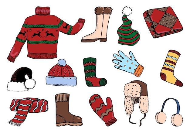 Doodles zestaw przytulnych zimowych ubrań. sweter, buty, rękawiczki, mitenki, czapki, szalik, skarpetki. ręcznie rysowane ilustracje wektorowe kolekcji. kolorowe elementy na białym tle na boże narodzenie projekt.