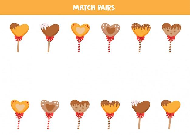 Dopasuj pary lizaków serca. znajdź dwie takie same, logiczne gry dla dzieci