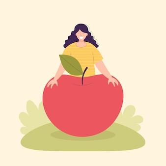 Dorosła kobieta rolnik z dużym jabłkiem koncepcja zbioru wegetarianizm zdrowa żywność
