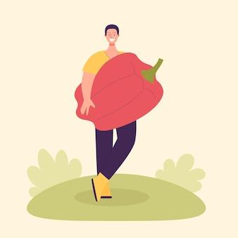 Dorosły rolnik płci męskiej z dużą papryką paprykową koncepcja zbioru wegetarianizm zdrowa żywność
