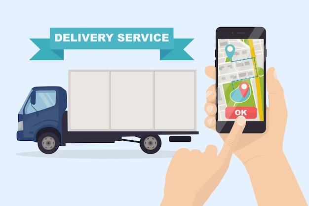 Dostawa ciężarówką, vanem. trzymaj telefon za rękę z aplikacją mobilną.