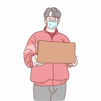 Dostawa Człowiek Ubrany W Maskę Medyczną, Trzymając W Ręku Pudełko Premium Wektorów