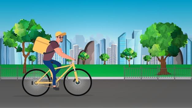 Dostawa jedzenia na rowerze. facet na rowerze jeździ po parku.