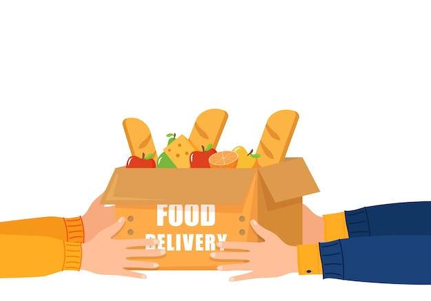 Dostawa jedzenia przez internet. dostawa żywności od kuriera do klienta. trzymaj ręce za papierową torbę na zakupy pełną produktów spożywczych.