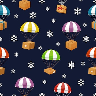 Dostawa prezentów w zimowe niebo z płatkami śniegu. prezenty parachute.