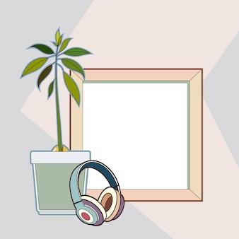Drewniana rama, słuchawki, roślina awokado.