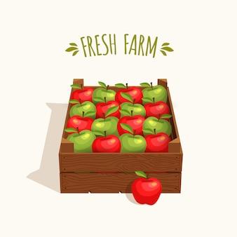 Drewniana skrzynia pełna jabłek czerwonych i zielonych